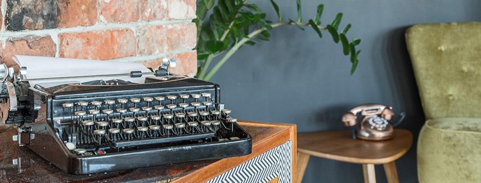 aetherium newsletter 4 antique typewriter armchair